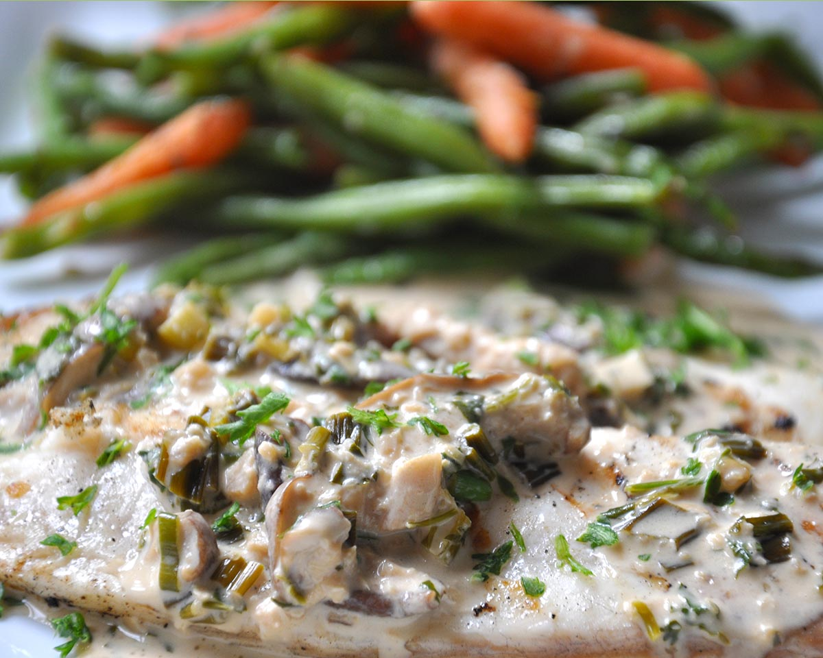 Grilled_Tilapia_Topped_with_a_Ginger-Shitake_Cream_Sauce